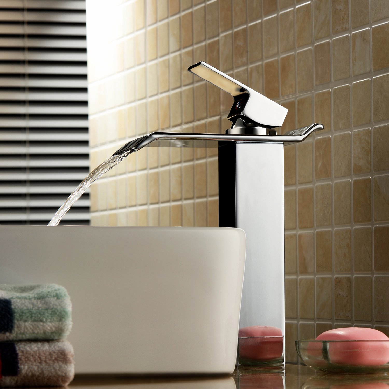 An exposed-bowl sink with a chrome or nickel faucet offers striking  contrast with dark